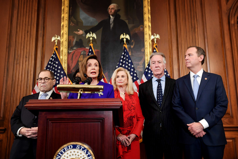 Image: House Speaker Nancy Pelosi holds a press conference with other ranking Democrats to unveil articles of impeachment against President Donald Trump at the Capitol on Dec. 10, 2019.