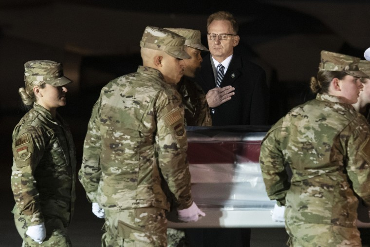 Image: Acting Navy Secretary Thomas Modly looks on as an Air Force carry team moves the transfer case containing the remains of Navy Seaman Apprentice Cameron Scott Walters