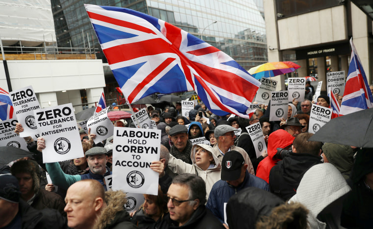 Demonstrators take part in an antisemitism protest outside the Labour Party headquarters in central London