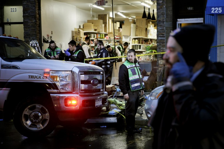 Image: Emergency responders survey the scene at a kosher supermarket where gunmen killed several people the day before in Jersey City, N.J., on Dec. 11, 2019.