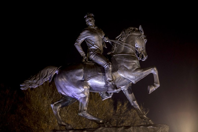 "Image: ""Rumors of War,"" a statue by artist Kehinde Wiley, during an unveiling ceremony at the Virginia Museum of Fine Arts in Richmond on Dec. 10, 2019. The statue depicts an African-American man dressed in contemporary clothing riding a horse, echoing th"