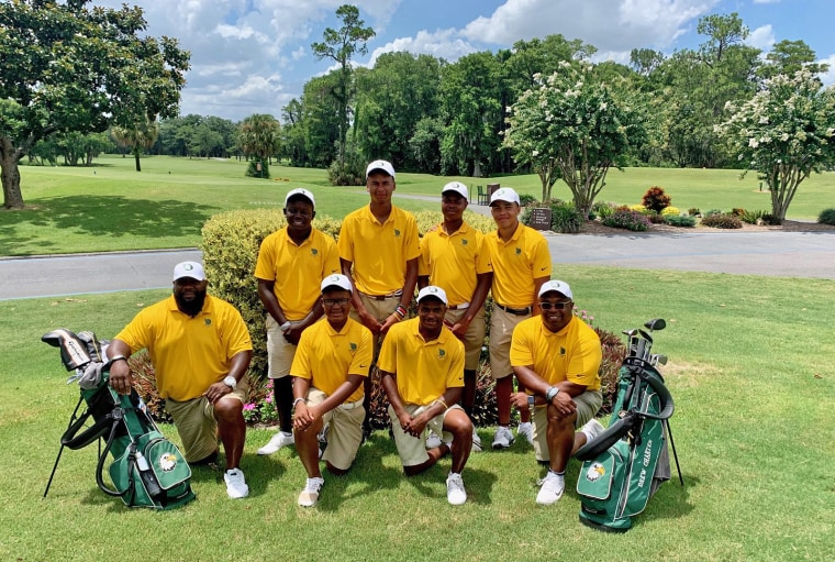 The Drew Charter School boys golf team, with coaches Joe Weems and Nyre Williams, at the Georgia State Golf Championship in May.