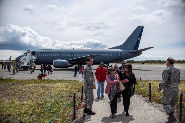 Image: Relatives of passengers on the Hercules C-130 aircraft of Chile's Air Force that crashed arrive at an Air Force base in Punta Arenas city
