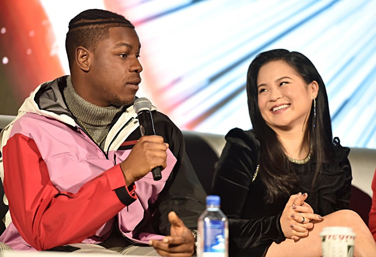 """Image: John Boyega and Kelly Marie Tran participate in the global press conference for """"Star Wars:  The Rise of Skywalker"""" at the Pasadena Convention Center"""
