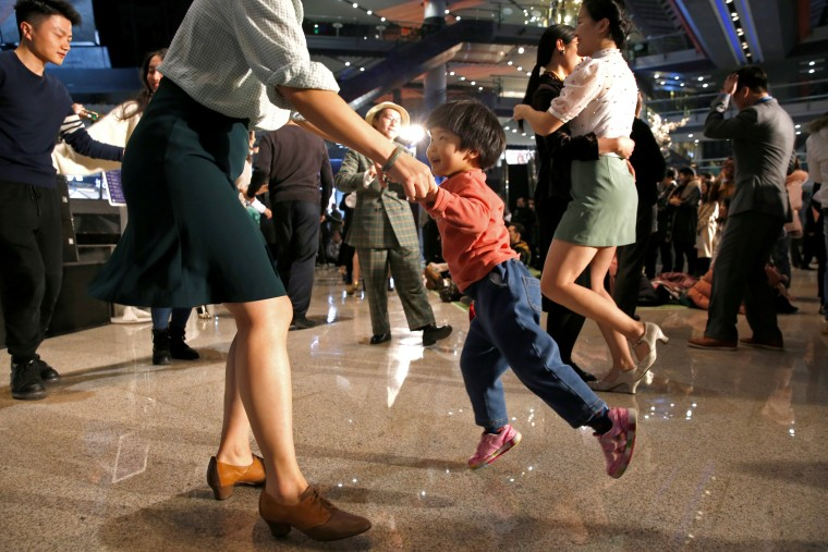 Image: People dance at a Retro Swing Night event in a shopping mall in Beijing