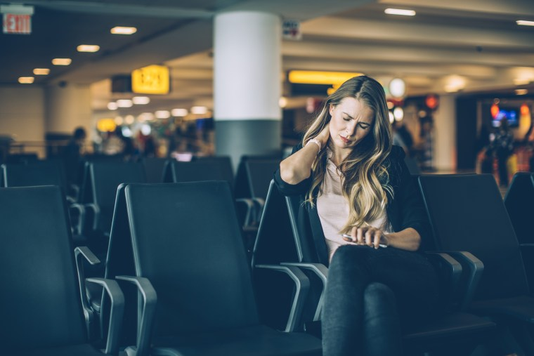 Image: Woman at airport waiting area