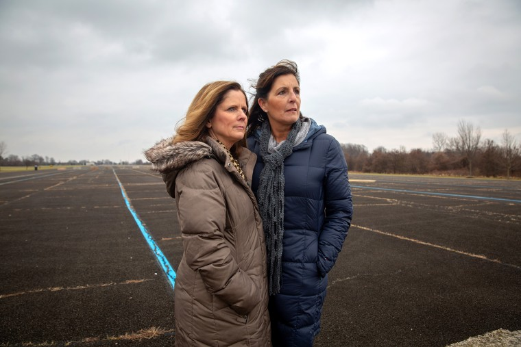 Joanne Stanton and Hope Grosse stand on the former runway at the Naval Warfare Center in Warminster, Pa.