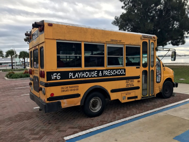 Image: A mother has been arrested after her three children were found unattended inside a mini school bus in Gulfport, Fla.