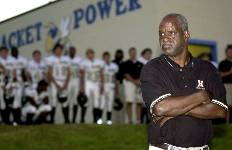 """Image: James """"Radio"""" Kennedy stands with the T.L. Hanna High School varsity football team in Fort Mill, S.C., in 2003."""