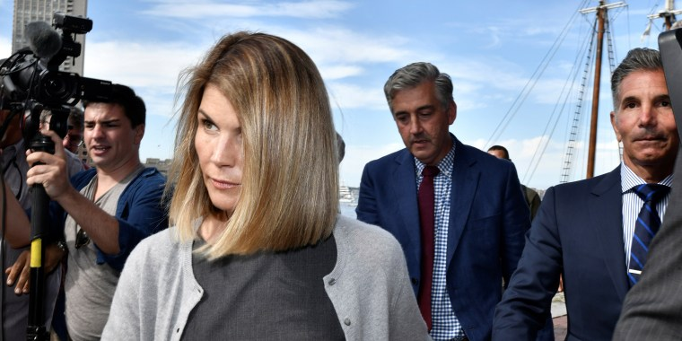 Image: Actress Lori Loughlin, and her husband, fashion designer Mossimo Giannulli leave the federal courthouse after a hearing on charges in a nationwide college admissions cheating scheme in Boston