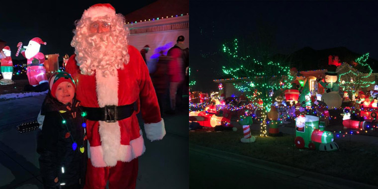 Dominic poses with Santa on the left and on the right, you can see some of the 100+ inflatables adorning their yard!