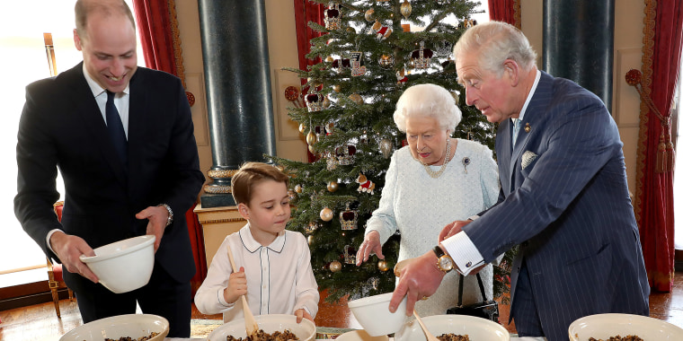 Queen Elizabeth, Prince Charles, Prince William and his son Prince George preparing special Christmas puddings at Buckingham Palace in December 2019.