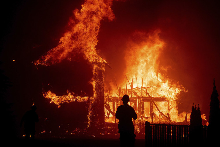 Image: A home burns as the Camp Fire rages through Paradise, Calif.