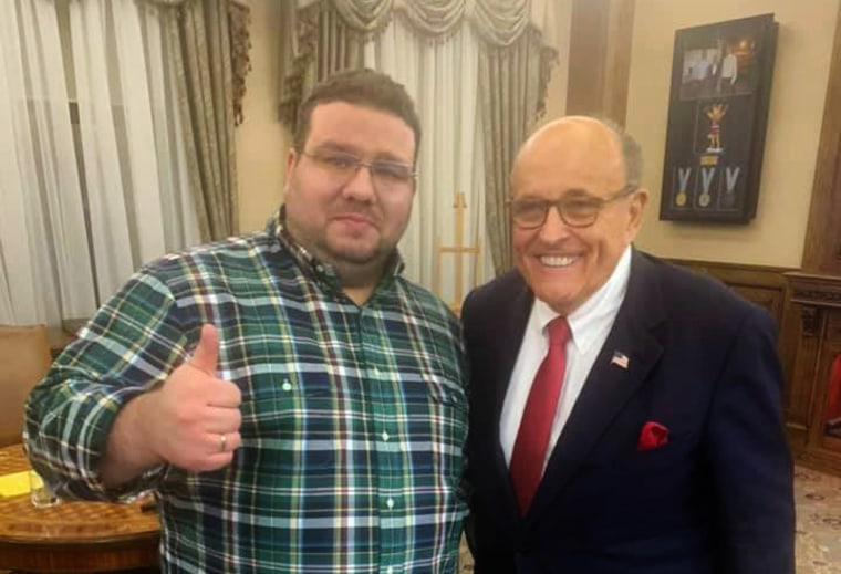 Ukrainian former diplomat Andriy Telizhenko and Rudolph Giuliani pose for a picture during a meeting in Kyiv on Dec. 5, 2019.