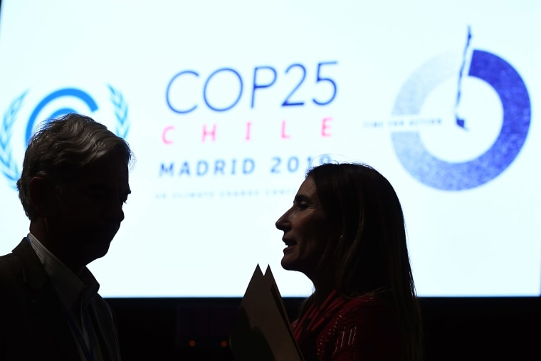 Image: Chile's Minister of Environment and COP25 president Carolina Schmidt (R) talks to Brazilian Secretary for National Sovereignty and Citizenship Fabio Mendes Marzano during the closing plenary session of the UN Climate Change Conference COP25
