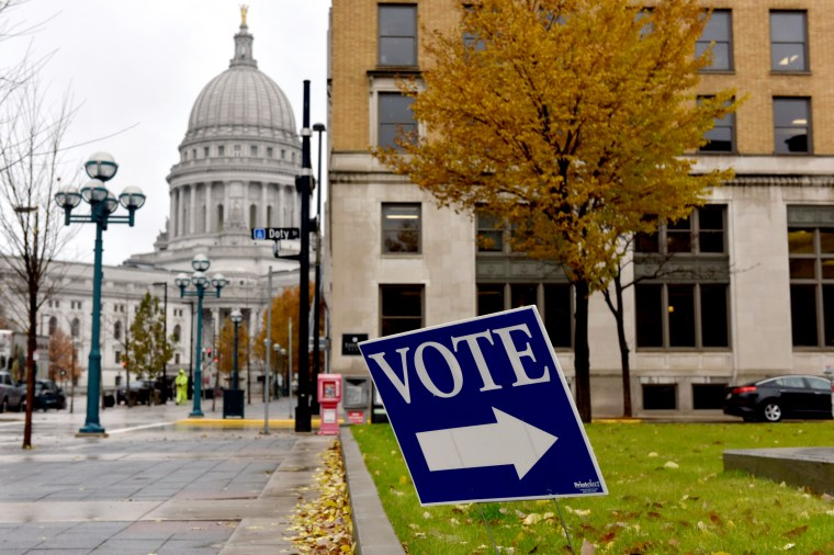Image: A sign for a polling place near the state capitol in Madison, Wis., on Nov. 6, 2018.