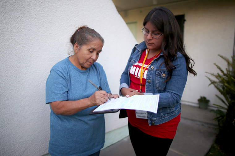 CHIRLA volunteer Diana Ramos registers Esperanza Artiga who emigrated to the U.S. from El Salvador 45 years ago, to vote in the U.S. presidential election in Los Angeles