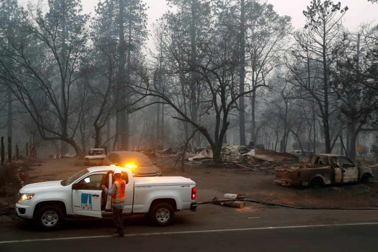 Employees of Pacific Gas & Electric work in the aftermath of the Camp Fire in Paradise, Calif., on Nov. 14, 2018.