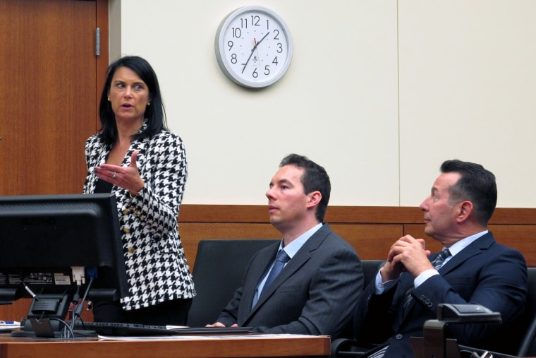 Dr. William Husel, center, sits between defense attorneys Diane Menashe and Jose Baez during a hearing on Aug. 28, 2019, in Columbus, Ohio.