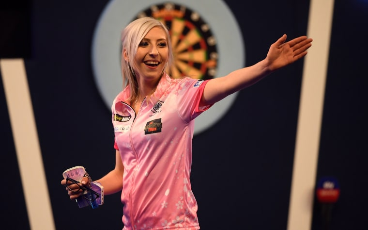 Image: Fallon Sherrock reacts after winning her 1st round game against Ted Evetts to become the first female to win a game in the PDC World Championships at Alexandra Palace