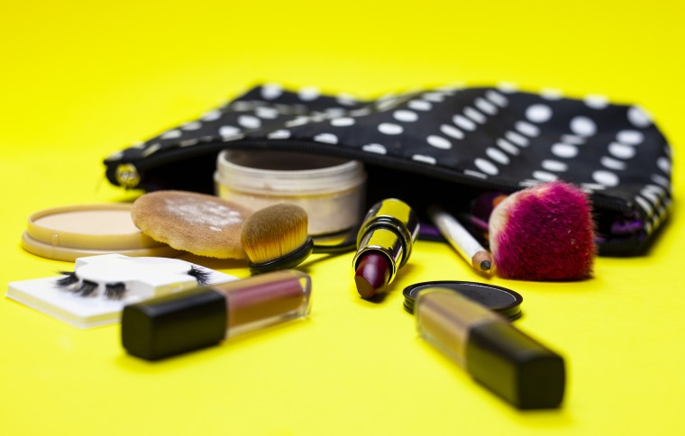 Cosmetics and Make Up Equipment on Yellow Background