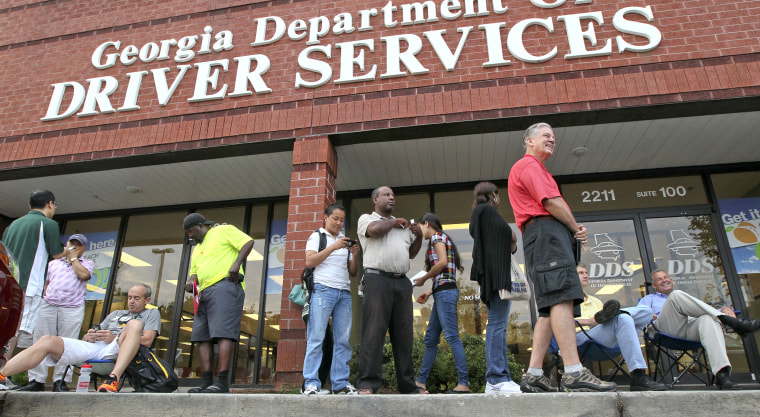 People wait outside the Georgia Department of Driver Services on July 6, 2012, in Atlanta.