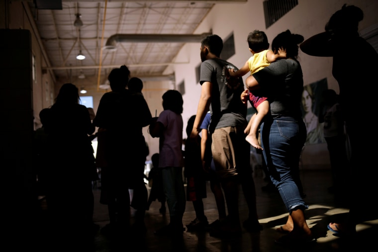 Image: Migrants who returned to Mexico from the U.S. under the Migrant Protection Protocols program line up for food at a migrant shelter in Ciudad Juarez on Sept. 26, 2019.