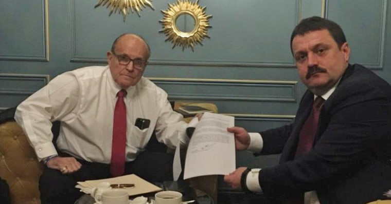 Image: Ukrainian lawmaker Derkach attends a meeting with U.S. lawyer Giuliani in Kiev