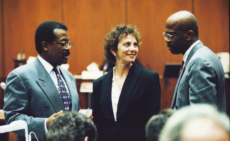 Defense attorney Johnnie Cochran Jr. confers with prosecutors Marcia Clark and Christopher Darden during testimony in the trial of O.J. Simpson in 1995.