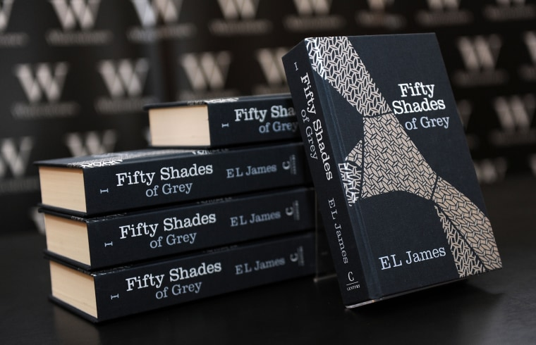 "A pile of ""Fifty Shades of Grey"" books by E.L. James"
