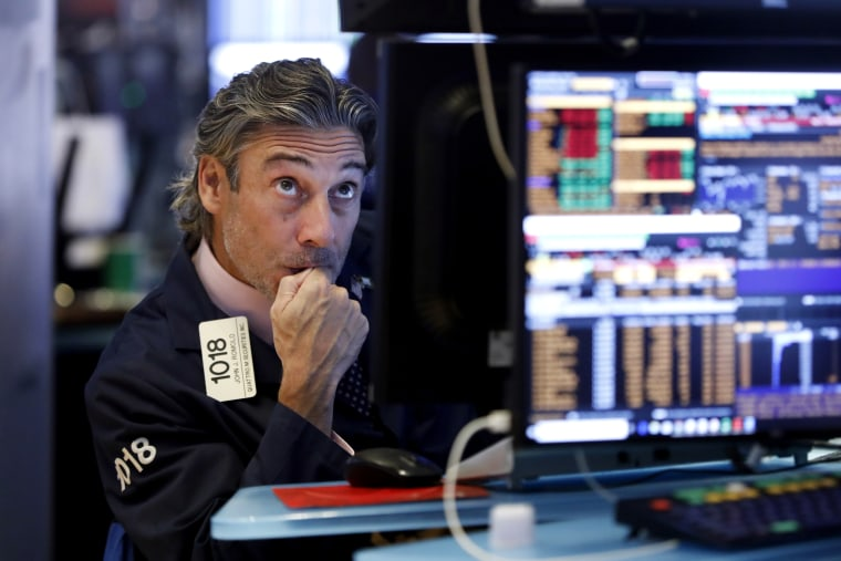 Image: A trader works the floor of the New York Stock Exchange on Aug. 14, 2019.