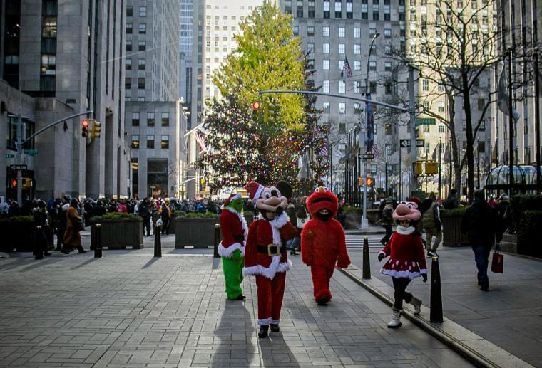 Image: Costumed performers leave Rockefeller Center in New York on Dec. 20, 2019.