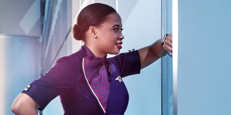 A flight attendant wearing the in-flight service exclusive dress for Delta.