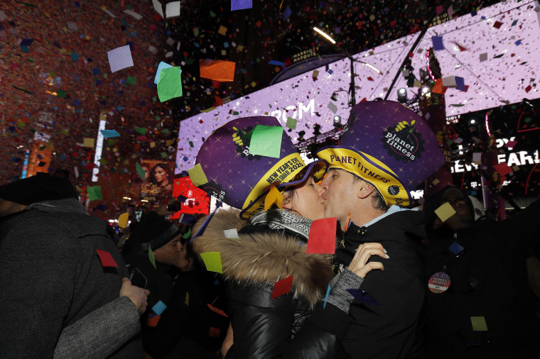 Sandra Desjardins kisses Jean-Charles Goulet both of Montreal, Canada, during a New Year's celebration in New York's Times Square, on Jan. 1, 2020.