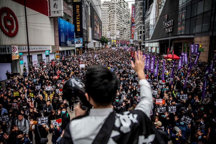 Image: Tens of thousands of protesters march in a New Years Day protest in Hong Kong.