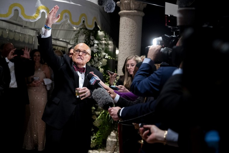 Image: Rudy Giuliani speaks to the press at a New Year's Eve party hosted by President Donald Trump at Mar-a-Lago in Palm Beach, Fla., on Dec. 31, 2019.