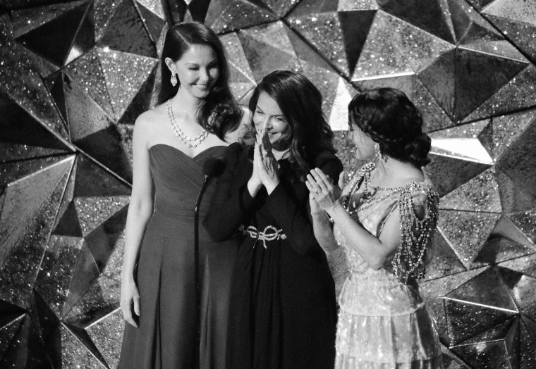 Image: Ashley Judd and Salma Hayek clap for Annabella Sciorra, center, at the 90th Academy Awards on April 3, 2018. All three actresses have spoken out about Harvey Weinstein's alleged sexual misconduct.