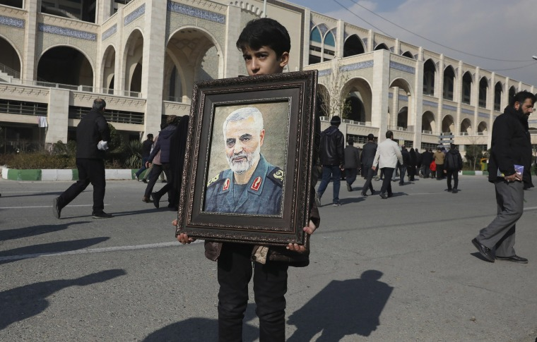 Image: A boy carries a portrait of Iranian Revolutionary Guard Gen. Qassem Soleimani, who was killed in the U.S. airstrike in Iraq, prior to the Friday prayers in Tehran