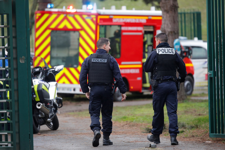 Image: French police secure an area after a knife attack in a public park in Villejuif