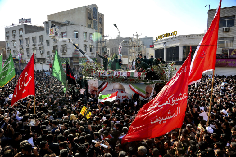 Image: The flag-draped coffins of Iranian General Qassem Soleimani and other military officials drive through the streets as mourners pay their respects in Ahvaz, Iran, on Jan. 5, 2020.