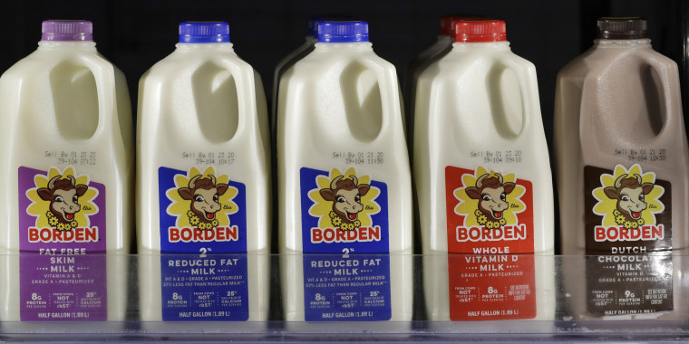 Borden milk rests on a shelf in a cooler Monday, Jan. 6, 2020, in Richmond Heights, Ohio. Borden Dairy Co. filed for bankruptcy protection, the second major U.S. dairy to do so in as many months. Borden produces nearly 500 million gallons of milk each year for groceries, schools and others.