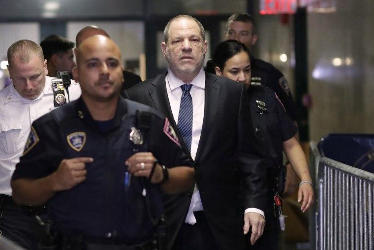 Image: Harvey Weinstein, center, enters State Supreme Court in New York