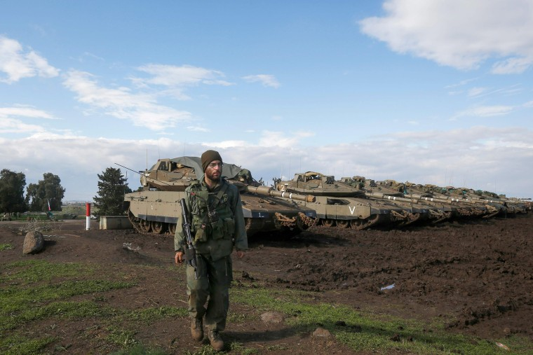 Image: Israeli troops are pictured in the Israeli-annexed Golan Heights on the border with Syria