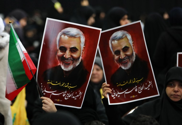 Image: Supporters of Shiite Hezbollah movement hold posters of slain Iranian major general Qassem Soleimani as the movement's leader delivers a speech on a screen in the Lebanese capital Beirut's southern suburbs