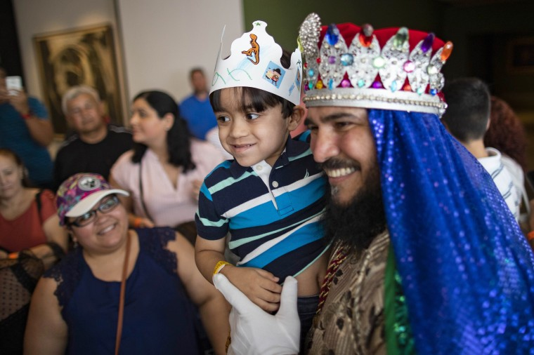Ian Miguel González Zayas shares a moment with one of the Three Wise Men at a Three Kings Day celebration at the Ponce Art Museum in Puerto Rico, on Sunday.