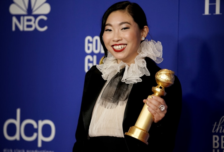 Image: Awkwafina poses with her Golden Globe Award for Best Actress on Jan. 5, 2020.