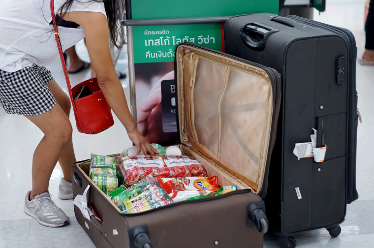 Image: According to a viral Facebook album with more than 70 pictures, a number of shoppers have replaced the plastic bags with suitcases.