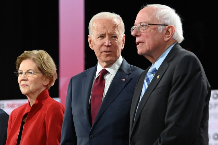 Democratic presidential hopefuls, from left, Massachusetts Sen. Elizabeth Warren, former Vice President Joe Biden and Vermont Sen. Bernie Sanders arrive ahead of a Democratic primary debate in Los Angeles on Dec. 19, 2019.