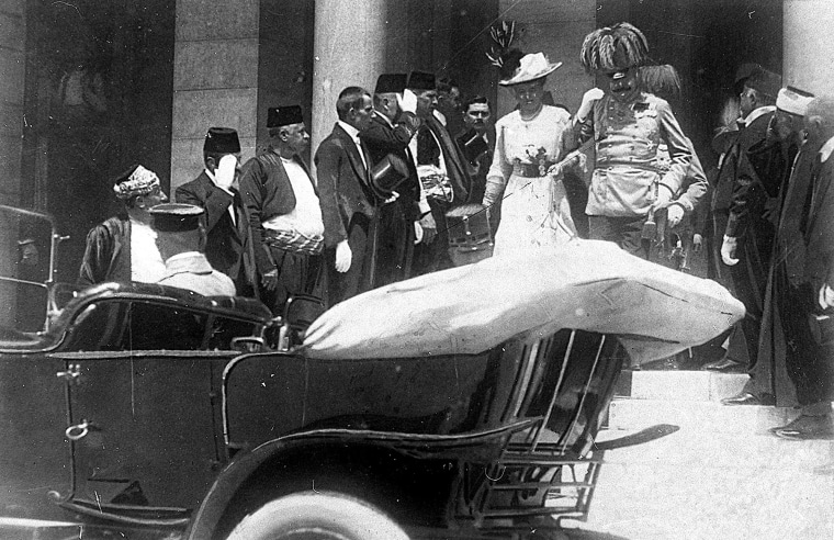 Archduke of Austria Franz Ferdinand walks to a car with his wife, Sophie, minutes before his assassination in Sarajevo on June 28, 1914.