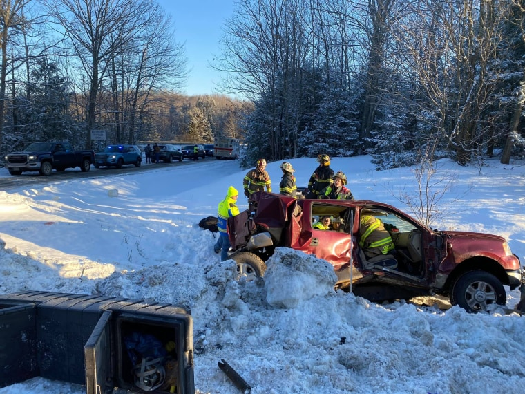 Firefighters work at the scene of a 30-car pileup in Carmel, Main, on Jan. 7, 2020.